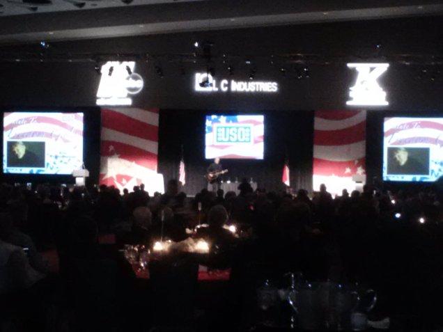 Kris Kristofferson performing on stage.