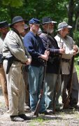 Civil War soldiers about to conduct a weapons demonstration for the public.
