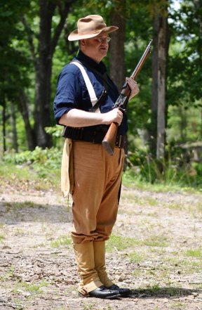 Spanish-American War soldier demonstrates his U.S. Army Krag-Jørgensen bolt-action rifle.