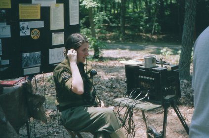 Operating the field phone communications network switchboard.