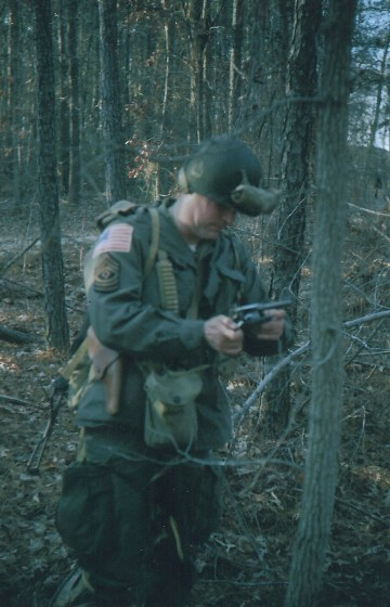 Easy Company top sergeant ejecting rounds from his service revolver.