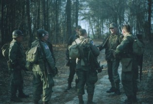 Easy Company, 506th, troopers speaking with an SS machine gunner.