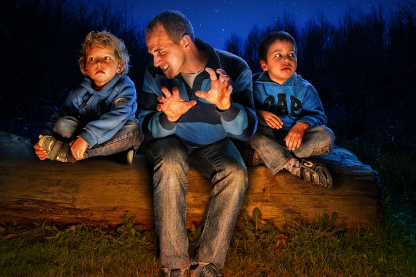 dad and two kids in forest