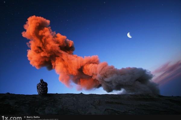 man watching smoke rising