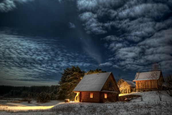 Night sky over a two shacks