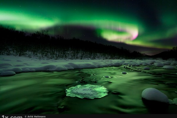 Aurora over a river