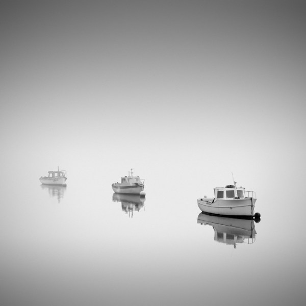 Black and white photo of three boats
