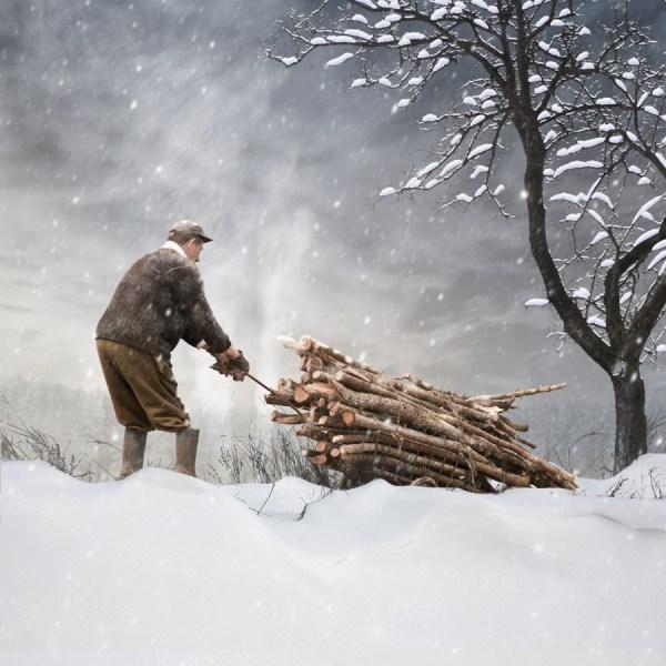 Man pulling lumber