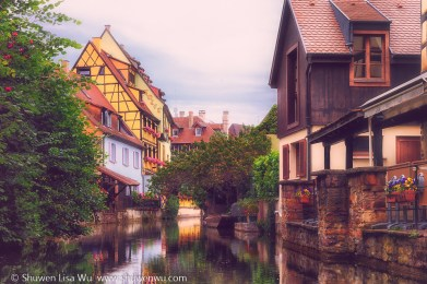 Channel - houses along the channel of La Petite Venise, Colmar, France.