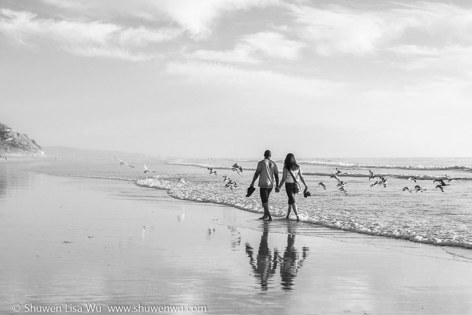 A couple enjoys a walk at South Cardiff State Beach, San Diego County, CA.