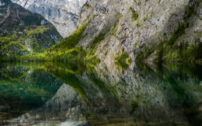 Reflections and Boathouse at Obersee, Nationalpark Berchtesgaden, Bavaria, Germany.