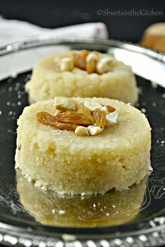 Rava sheera formed into two rounds and topped with nuts