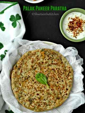 Palak paneer paratha garnished with some fresh herbs