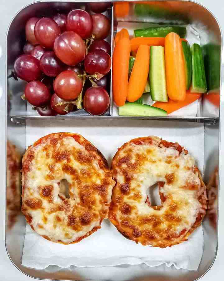 bagel pizza, cucumber & carrot sticks,red grapes