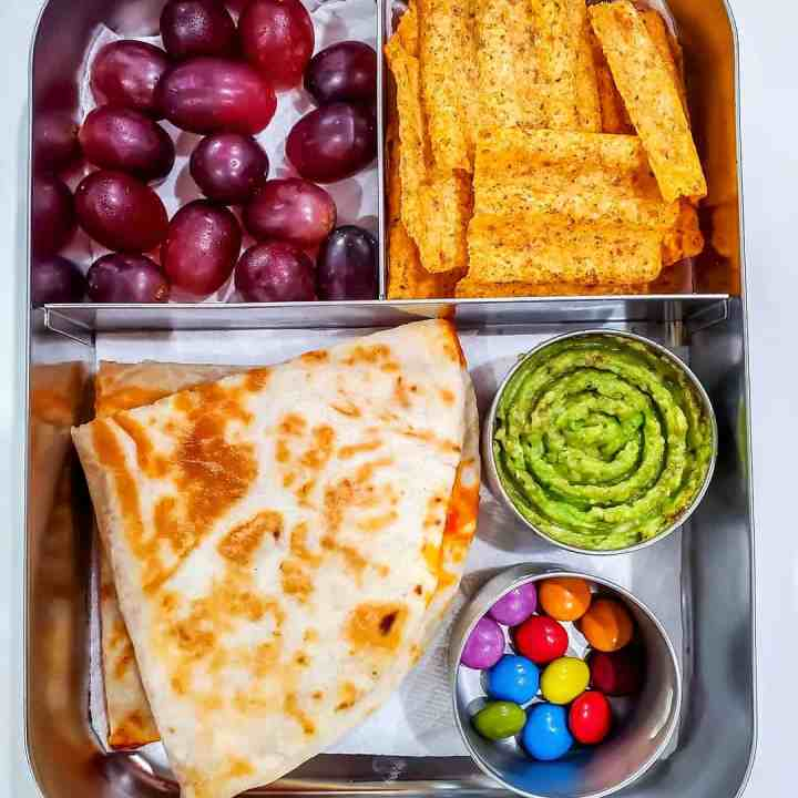 Quesadilla,Guacamole, chips, grapes and chocolate drops