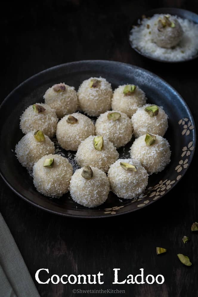 3/4th side/slant angle view of a plate full of coconut ladoo