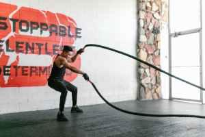 man holding battle ropes