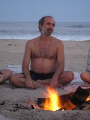 Satsang on the beach by fire