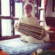 Shyamdas plays the pakhavaj drum, at home in Jatipura