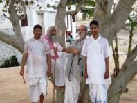 Mohan, Hasmukh, Shyamdas and Akash by the sacred tree at Chir Ghat baithak, Braj