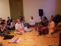 Shyamdas and friends listen intently to Radhanath Swami