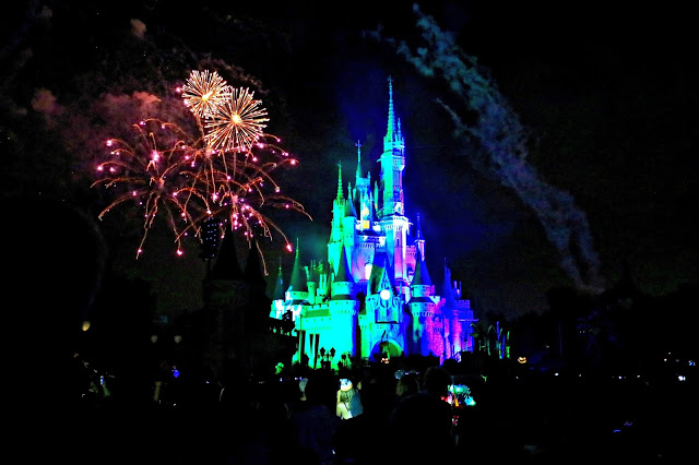 Cinderella's castle light up with fireworks during Mickey's Not so Scary Halloween Party