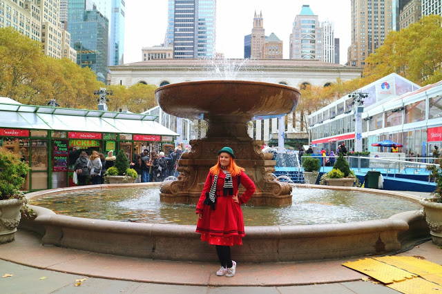 Kariss in front of a water fountain on Thanksgiving in NYC