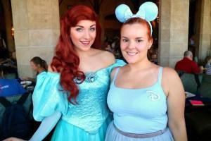 woman in blue clothing with Ariel in Walt Disney World