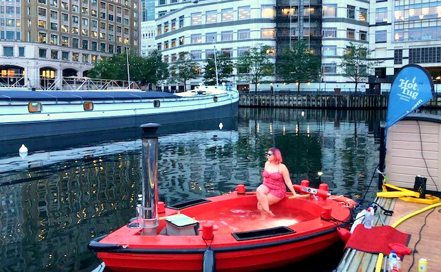 Kariss sitting in the HotTug on the Thames in a swimming costume
