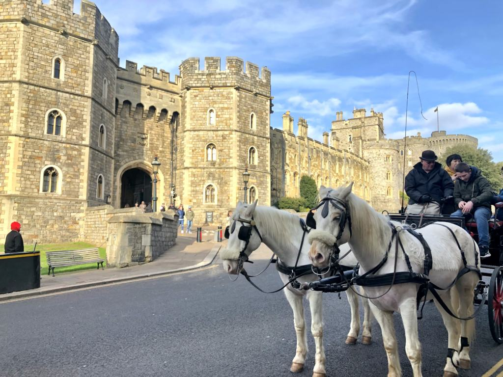 white horses and cart in front of Windsor Castle