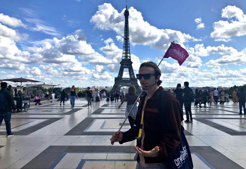 CityWonders tour guide in front of the eiffel tower tower