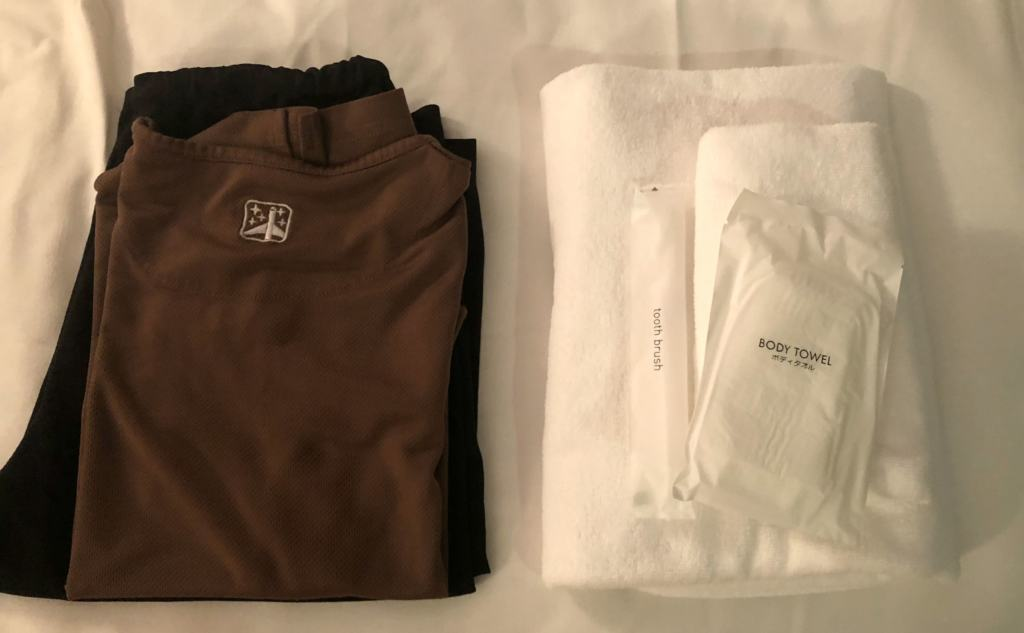 pjs, towel and personal care kit provided by the capsule hotel