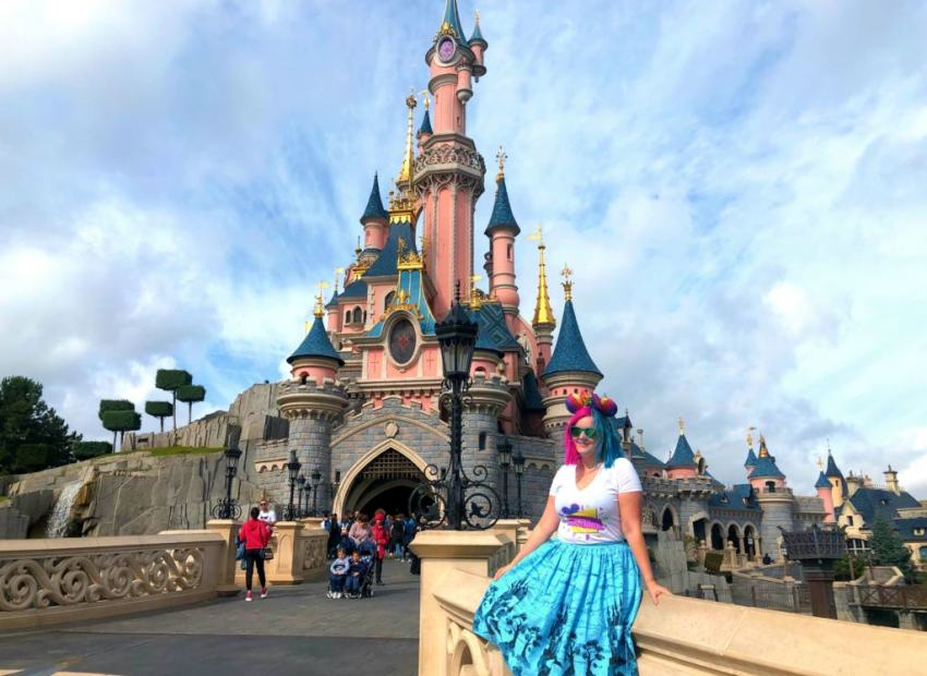 Kariss sitting in front of the castle in Disneyland Paris