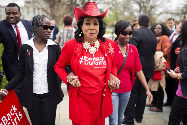 Rep. Frederica Wilson (D.-Fla.) walks with Nigerian students after a news conference.