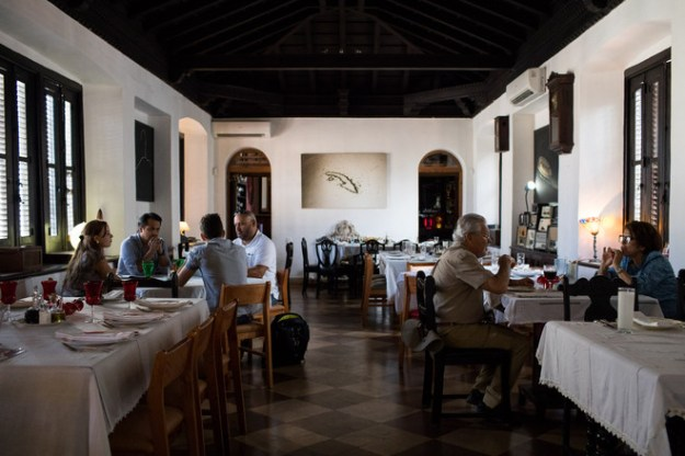 Havana's Atelier restaurant was largely empty at lunch last Friday. Owner Niuris Higueras, below, says business is down 60% from 2016.