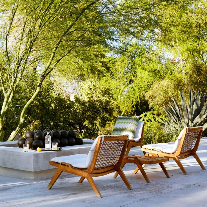 LESS-BLOCKY LOUNGERS Standard Architecture, in Los Angeles, placed teak chairs from Henry Hall Designs around a Palm Springs fire pit.