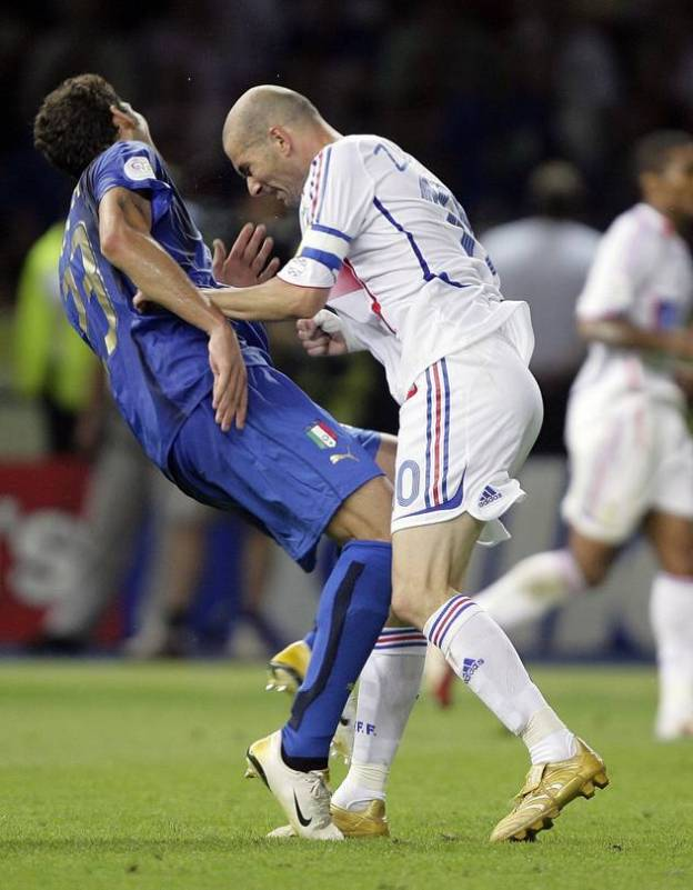 Italy's Marco Materazzi falls on the pitch after being head-butted by France's Zinedine Zidane (during the 2006 World Cup final.