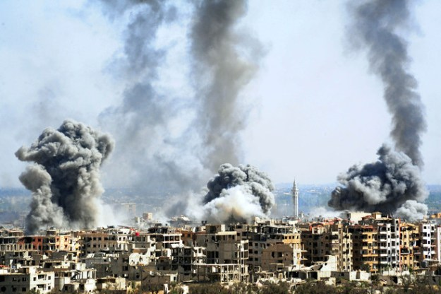 Smoke rises after the Syrian army shelled the Douma district in Eastern Ghouta on April 7.