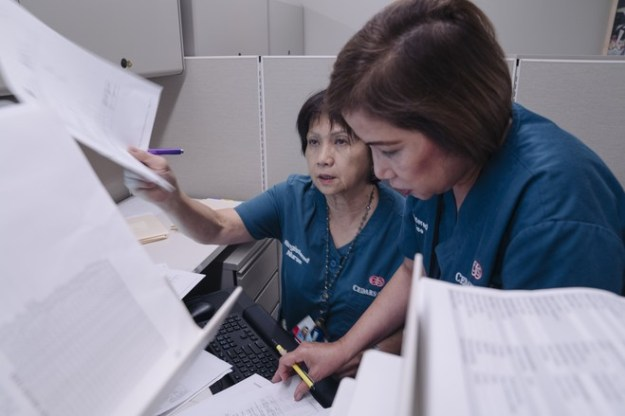 Gertrudes Tan, right, and Nora Levid, who were in kindergarten together, work in the same unit at Cedars-Sinai.