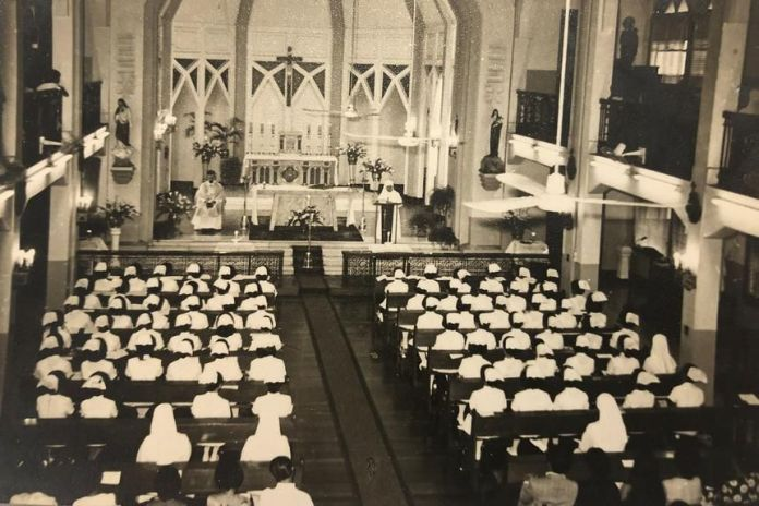 At St. Paul College of Nursing in Manila, the nursing students' capping ceremony in 1973 was followed by mass in the school's chapel.