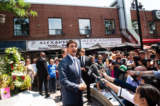 Canadian Prime Minister Justin Trudeau visits a memorial to the victims of the July mass shooting in Toronto.