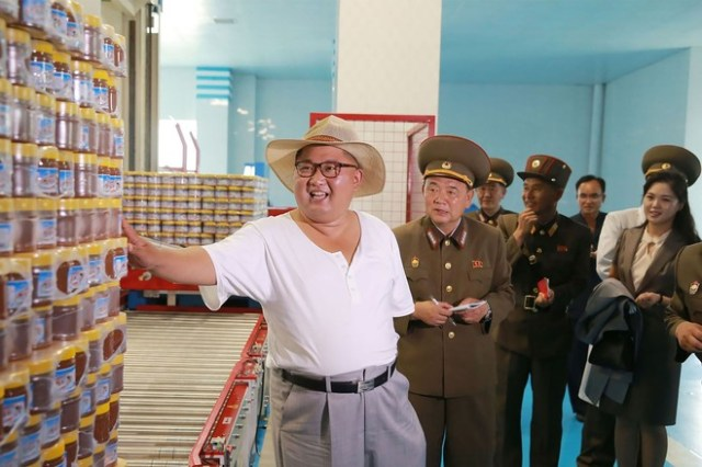 North Korean leader Kim Jong Un has shifted attention to his country's economy, and state media have made much of his tour of factories, farms and other economic facilities. Here he visits a fish pickling factory with his wife, Ri Sol Ju (right), in an undated photo released by the official Korean Central News Agency this month.