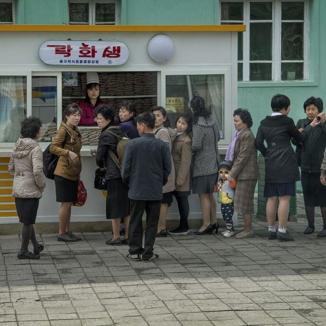 Signs of marketization are spreading in North Korea, much of it, including some state-run shops, driven by private capital. Here, a food kiosk in Pyongyang in April.