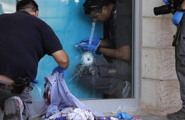 Israeli police inspected the location where an Israeli-American man was stabbed at a shopping mall at the Gush Etzion junction in the West Bank.