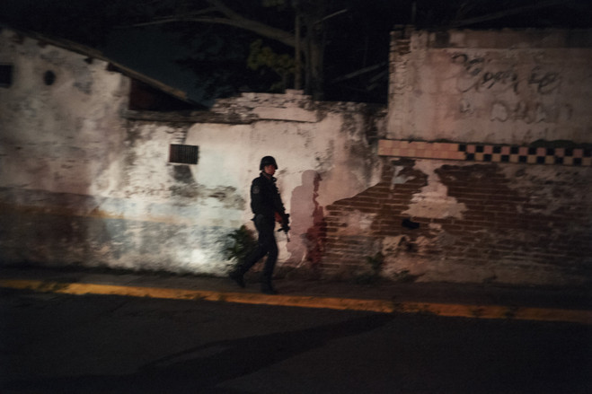 Mexican state police stop cars to search for firearms after cartel members fired on a taxi stop.  Latin America Is the Murder Capital of the World B3 BU534 0917la H 20180917231932