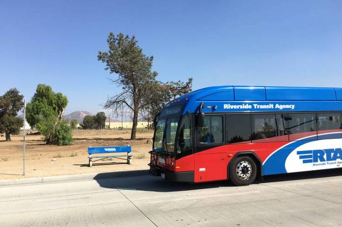 A Riverside Transit Authority bus stop in Perris, Calif., on a route that includes  distribution centers for Home Depot, Ross Stores and Amazon.com.