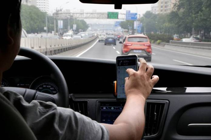 Didi Chuxing beat back rivals in China after raising about $24 billion over the past six years, but it remains unprofitable. Here, a Didi Chuxing driver in Beijing this past summer.