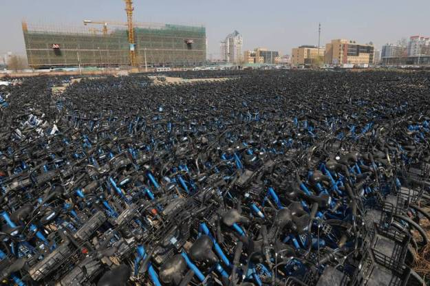 After rapid expansion across China, several bike-share companies are now facing cash-flow concerns. Here, Bluegogo bicycles await repair at a site in Beijing earlier this year.