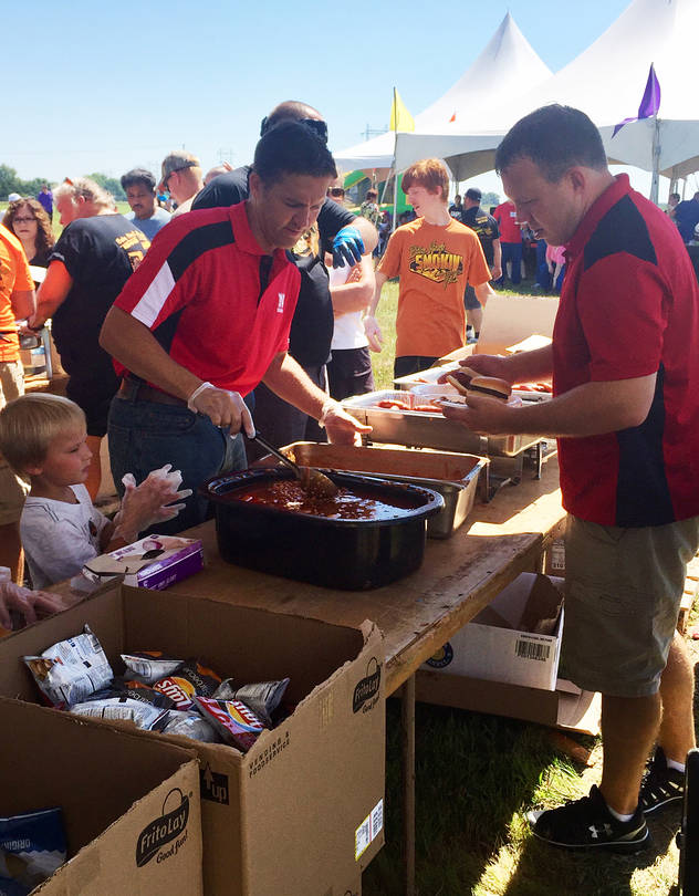 Sen. Sasse serving food at a picnic for a meat packing plant in Fremont, Neb., this summer.