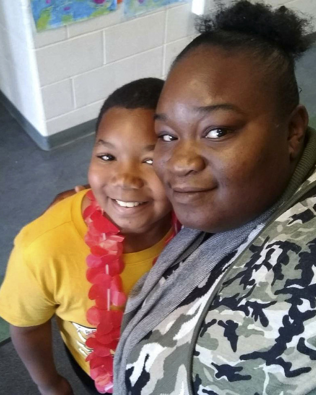 Shae Moore works seven days a week for two home-care agencies, which leaves little time to spend with her 9-year-old son Ty'Varus.  Caregivers Do Double Duty to Make Ends Meet B3 CE248 DOUBLE GR 20181025170212